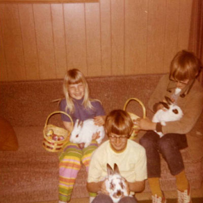 Old photo of family with pet rabbits